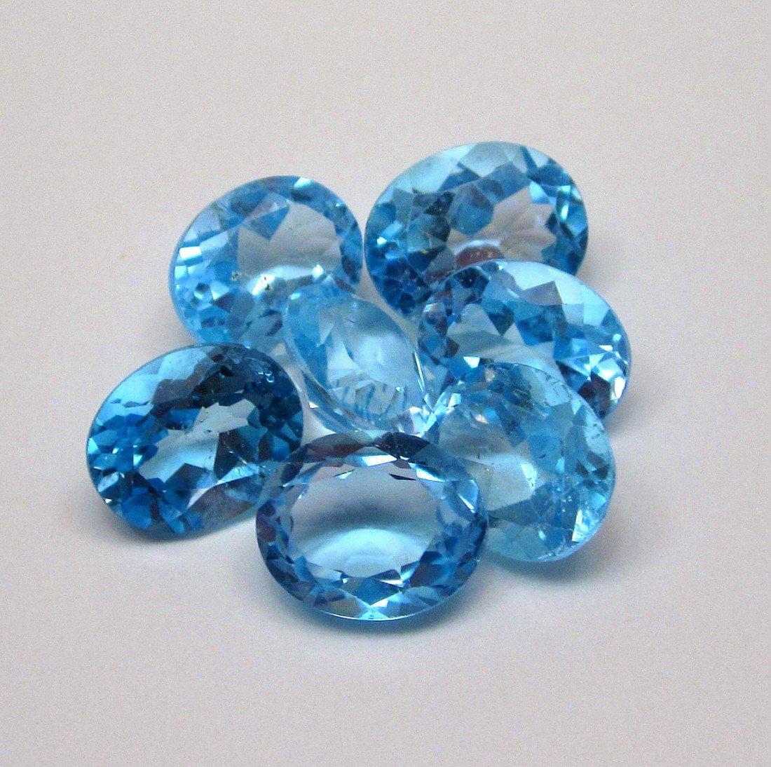 2W: A 31.40 ct Loose Topaz parcel gemstone VVS