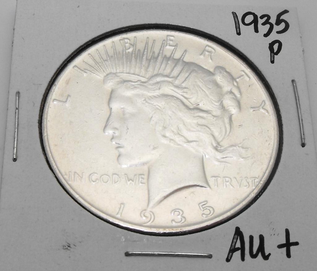 27: 1935 P AU Peace Dollar