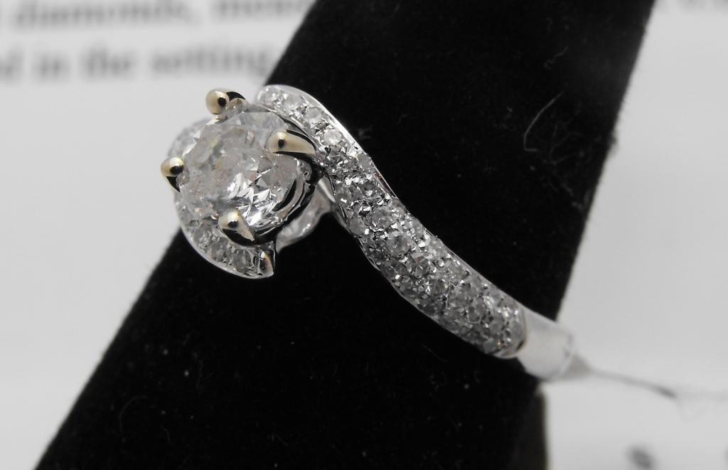 26M: $5,650 appraised Diamond Ring