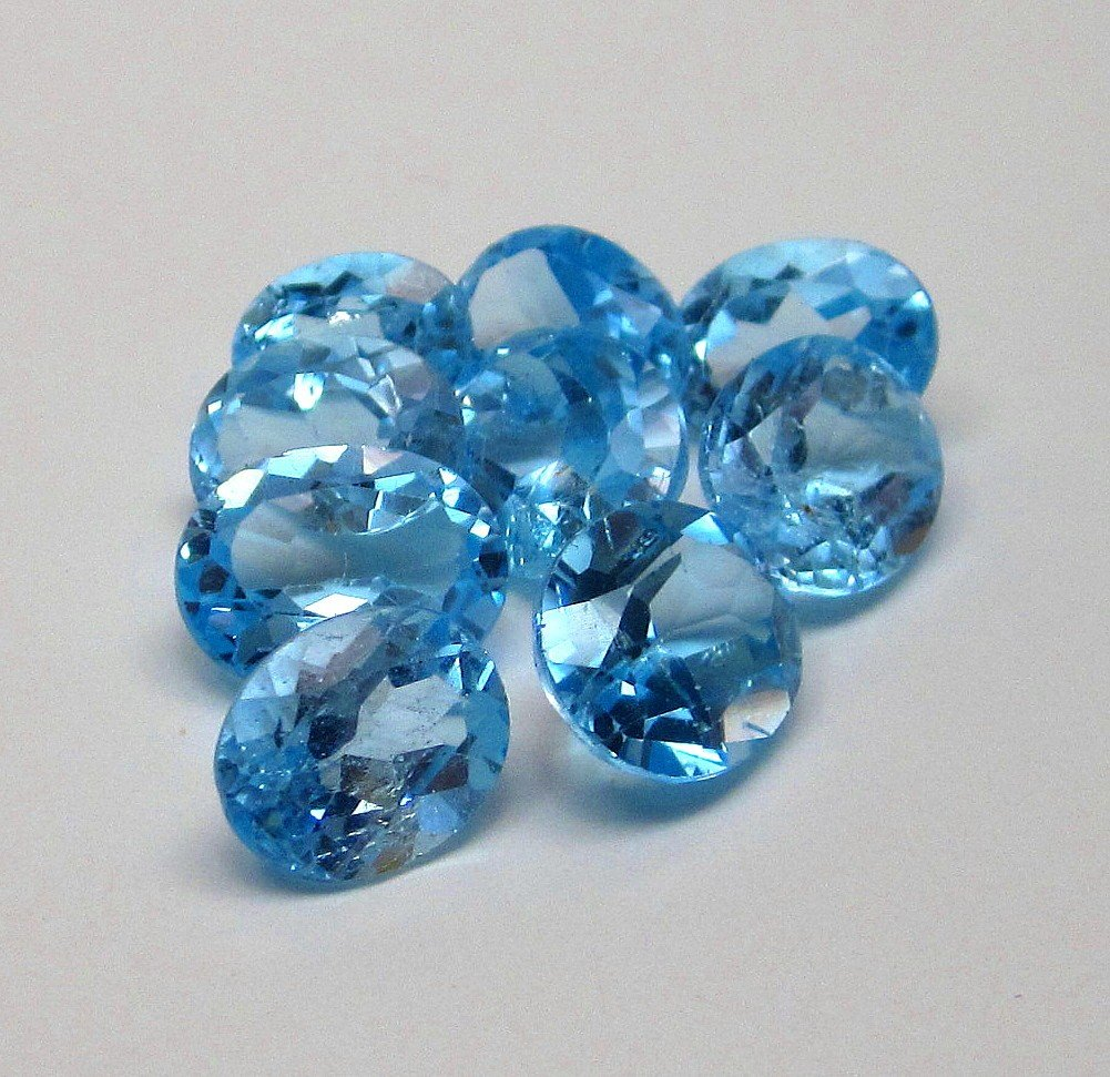 1J: A lot of approx. 25 cts. Blue Topaz
