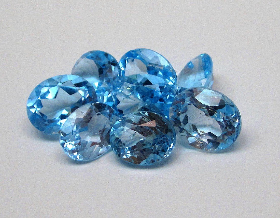 9J: A lot of approx. 25 cts. Blue Topaz