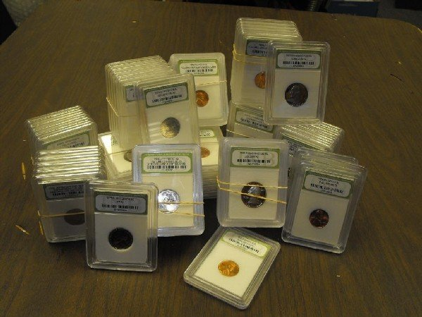 63: A Lot of 100 Slabbed MS Grade BU Plus Coins