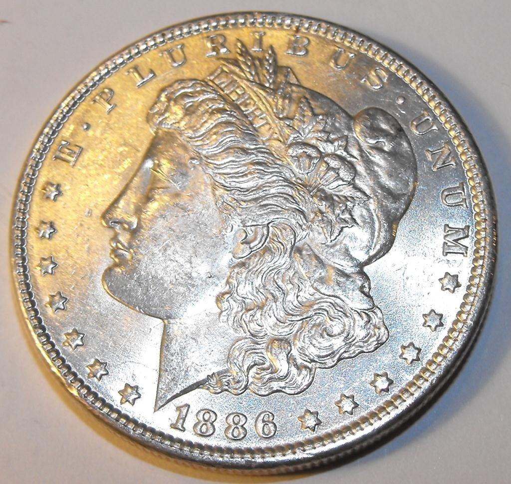 28: 1886 P BU Morgan Dollar