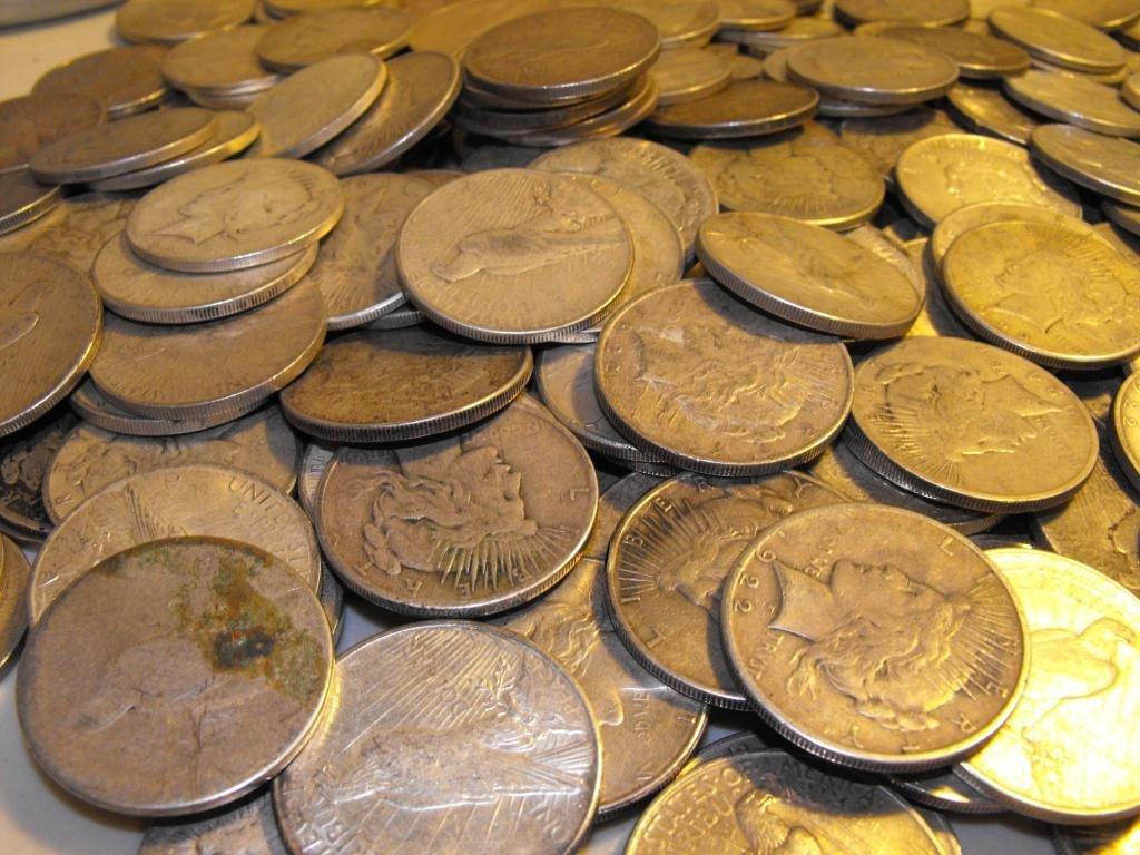64R: (100) Peace Silver Dollars