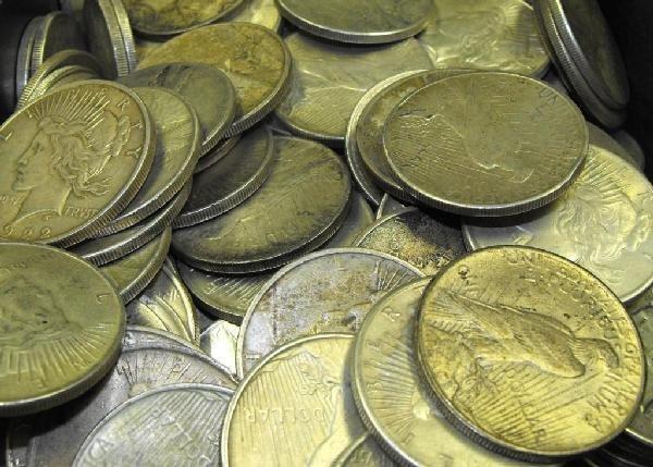 7O: Lot of 100 Circulated Silver Peace Dollars