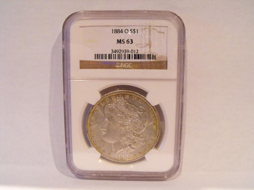 7T: 1884 o MS 63 NGC Morgan Dollar