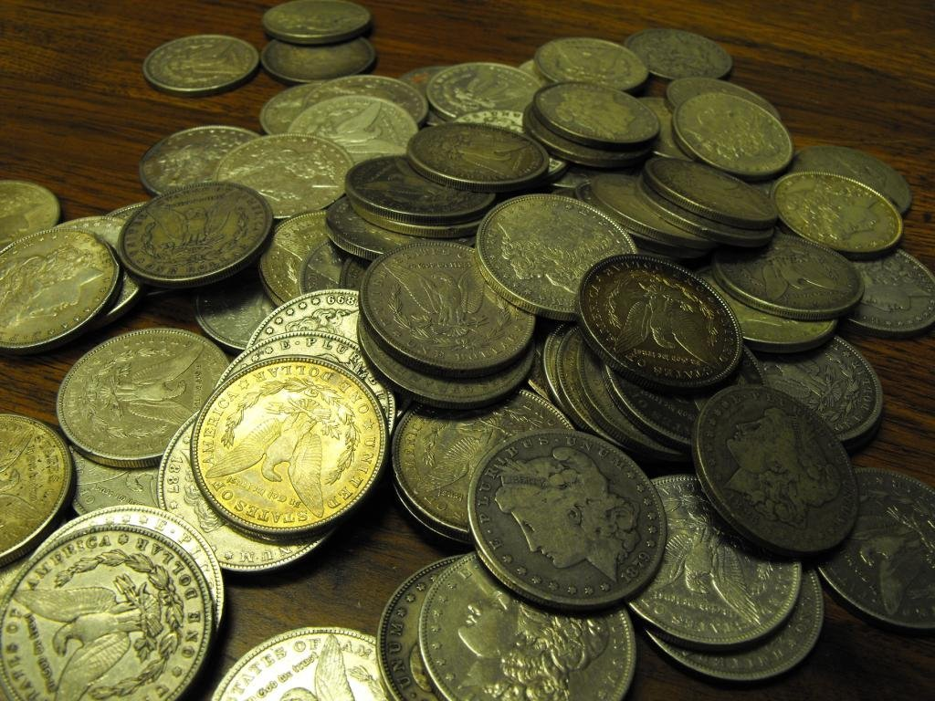 20 Assorted date Morgans from cache