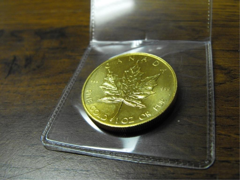 1 Oz. Pure Gold .999 or better Maple Leaf