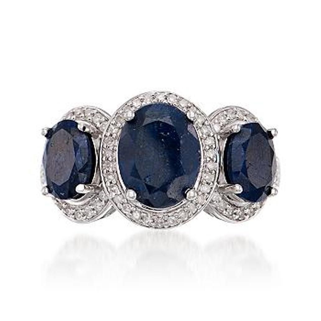 4.10 ct. t.w. Sapphire Three-Stone Ring With Diamonds