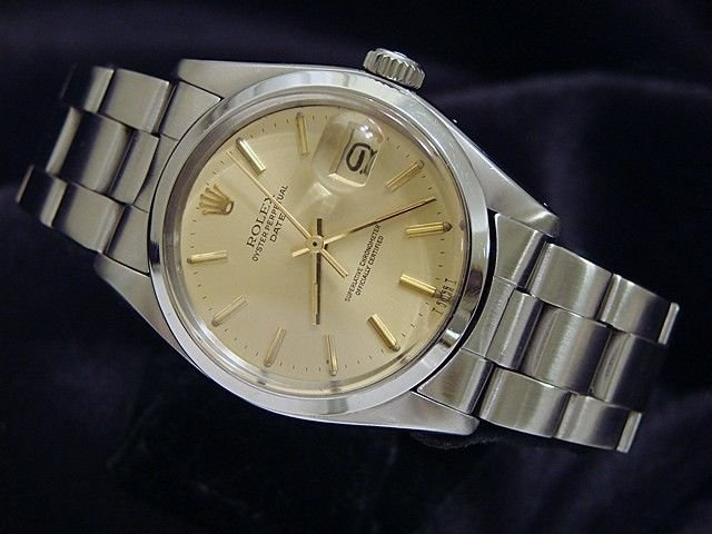 Man's Rolex Stainless Gold Dial