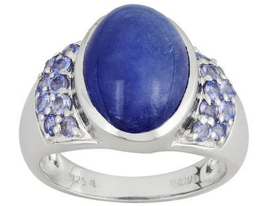 Tanzanite Oval Cabochon With .63ctw Round Faceted