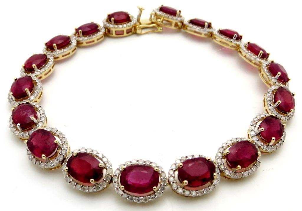 $13,240 21.89 ct. Ruby 2.41 Dia. Bracelet