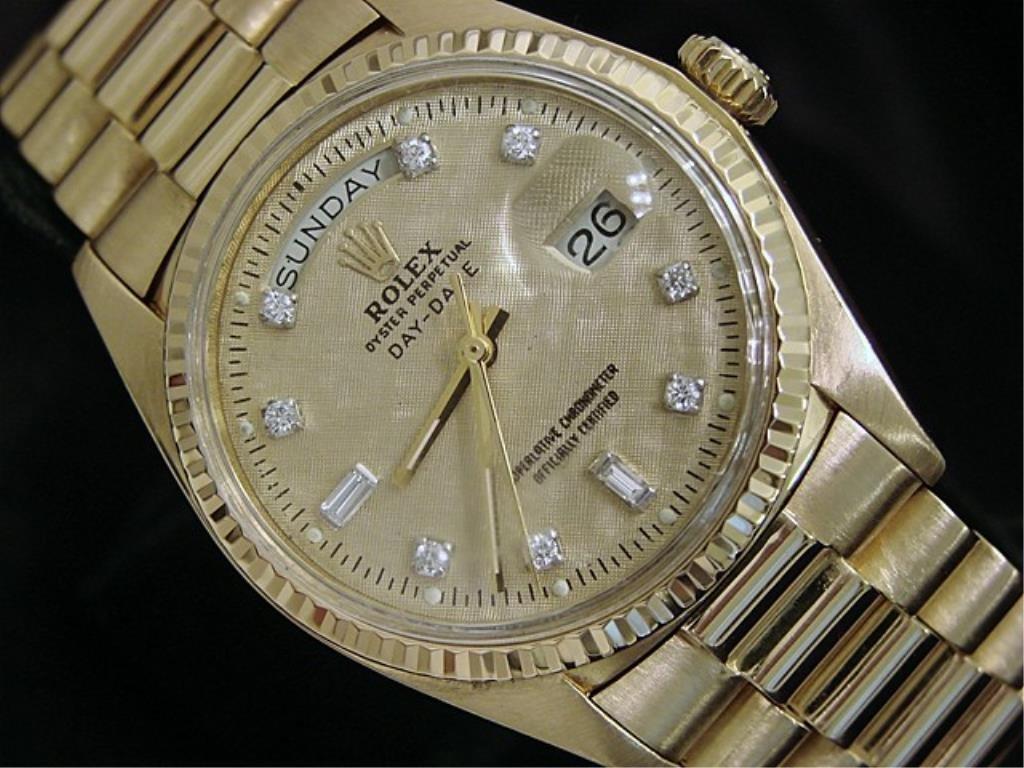 $30,000 18k YG Rolex President Day Date Diamonds
