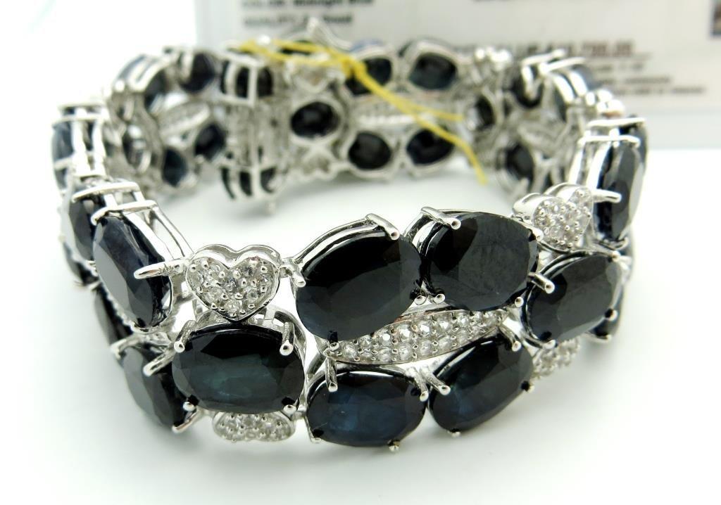 $10,700 Sapphire & Topaz Chunky Bracelet