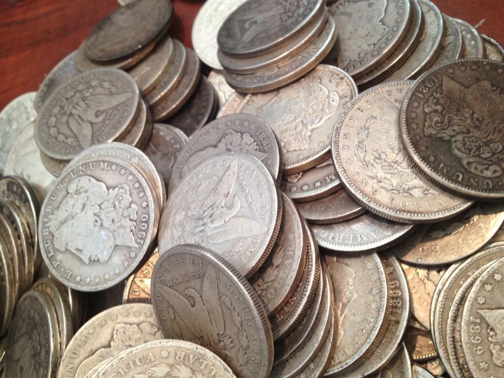 Lot of 100 Assorted Date & Grade Morgan Dollars