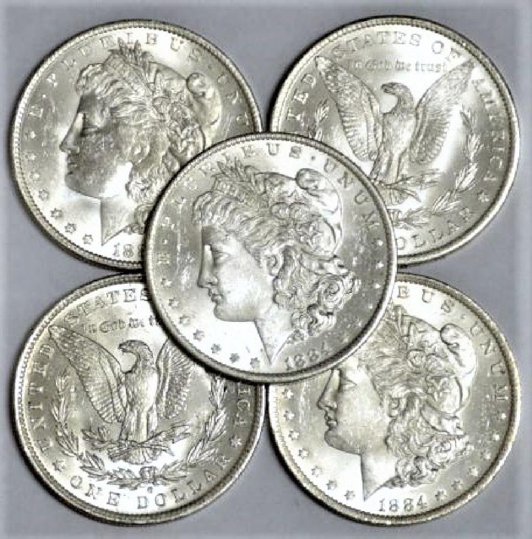 (5) 1884 O Bu Morgan Silver Dollars
