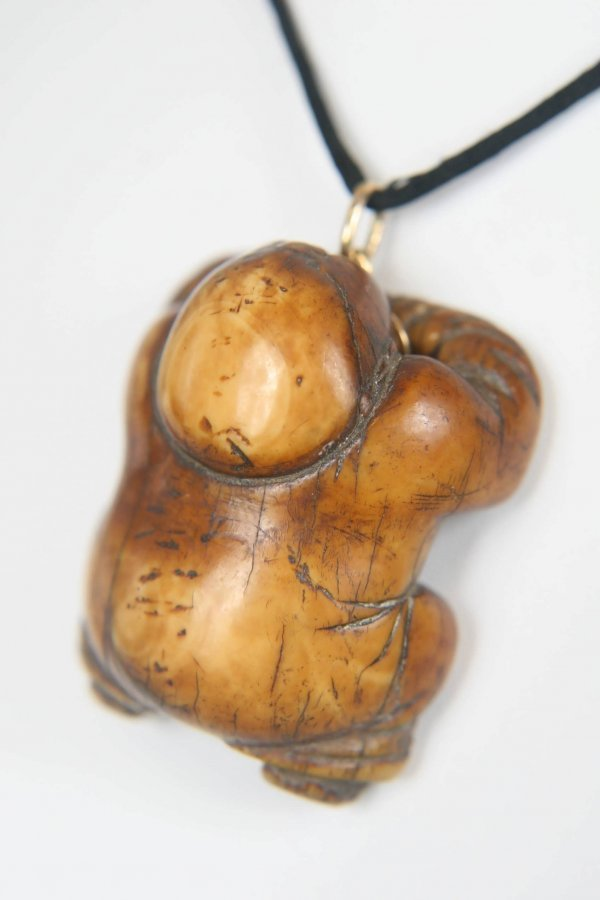 2300: EARLY ANTIQUE HAND CARVED PENITENT CHILD NETSUKE