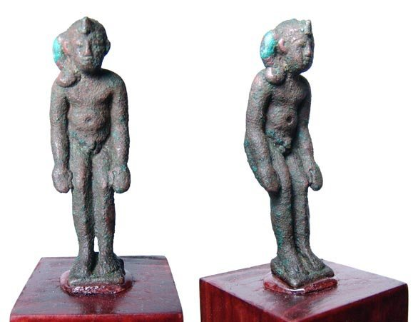 10: A Late Period bronze statuette of Harpokrates, in s