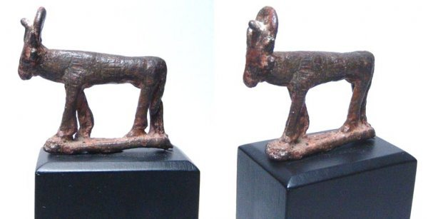 11: A Late Period bronze statuette of the Apis Bull