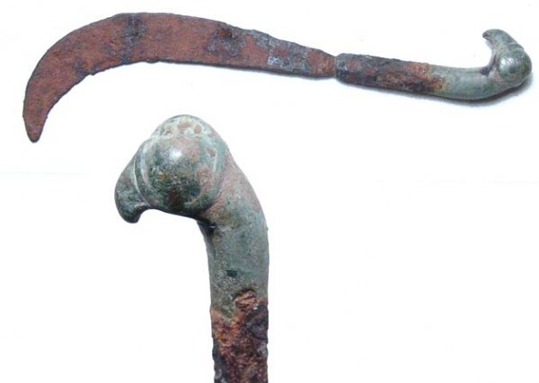 253: A Roman iron knife with curved blade set into a br