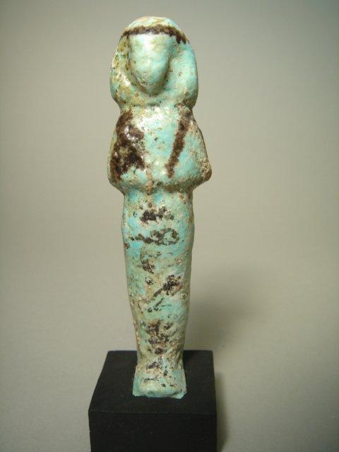 504:  Egypt, XXI Dynasty, a light blue faience ushabti
