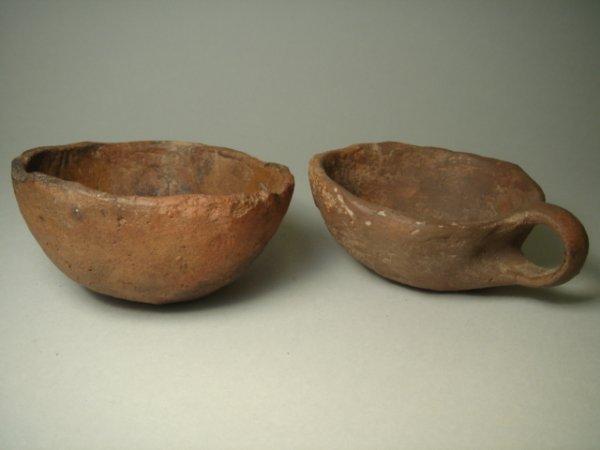 519:  Roman, c. 1st-3rd century, a pair of crude terra