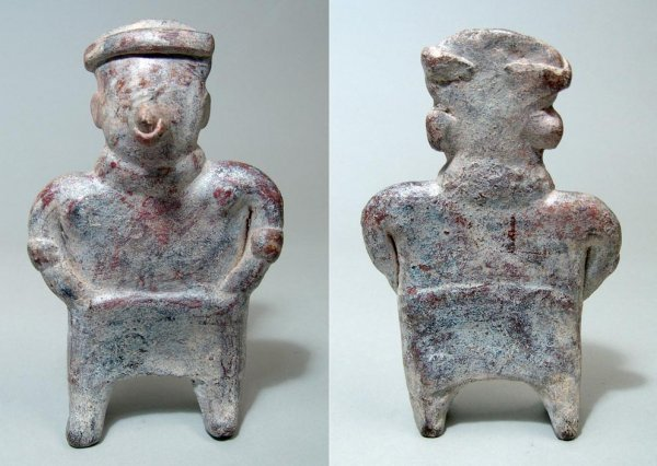 8: West Mexico, Nayarit, a standing male figure with wi
