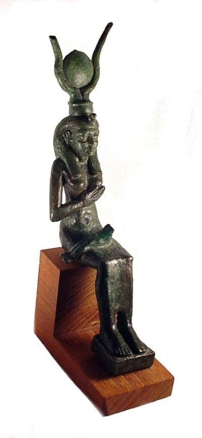 4: A large bronze statuette of Isis seated su