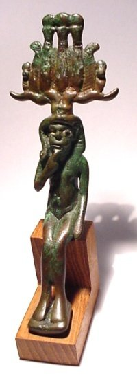 9: A bronze seated statuette of Harpokrates,