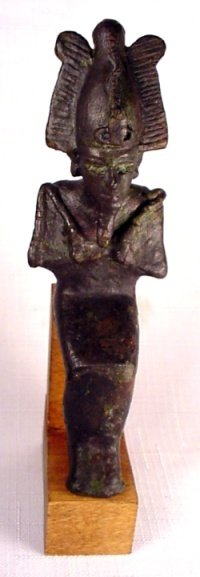 21: A hollow bronze seated statuette of Osiri