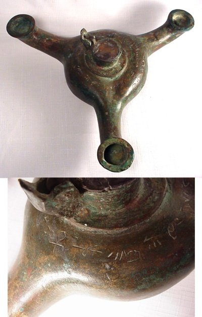 22: A very rare three spouted bronze oil lamp