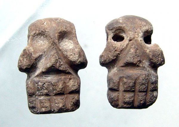 12: A Nice Pair of Aztec Stone Skull Pendants