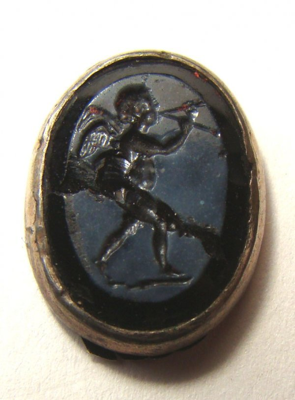 533: Roman, c. 1st - 2nd Century AD. A glass ringstone,