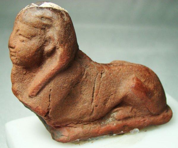 523: Egypt, Late Period, reddish colored sphinx figure