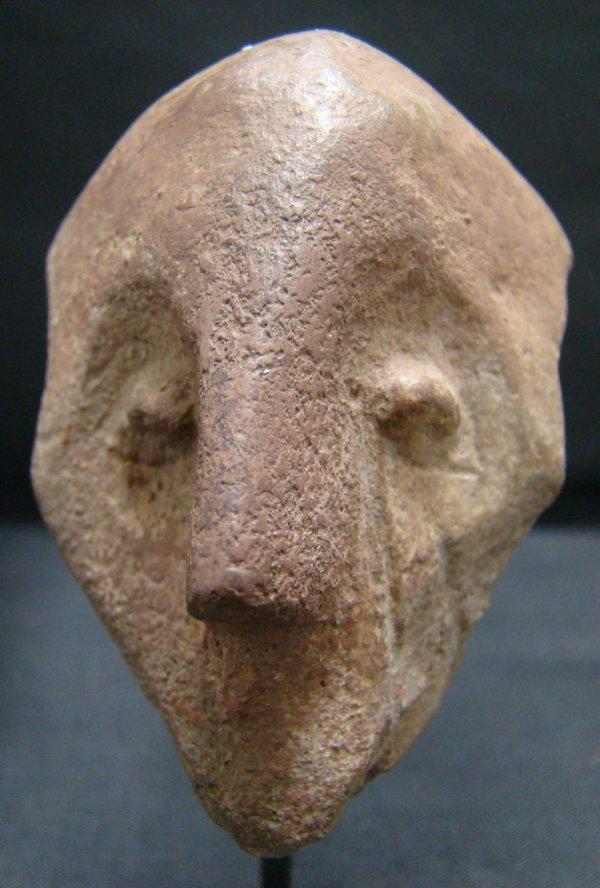 "2: 6th-3rd Millennium. ""Vinca"" terracotta head fragment"