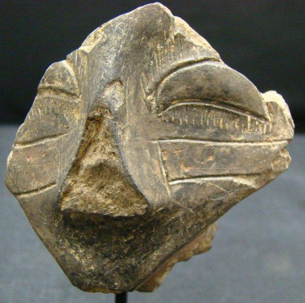 "3: 6th-3rd Millennium. ""Vinca"" terracotta head fragment"