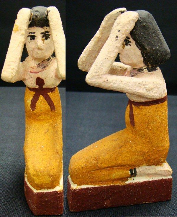 12: Egypt, New Kingdom, kneeling wooden figure of Isis