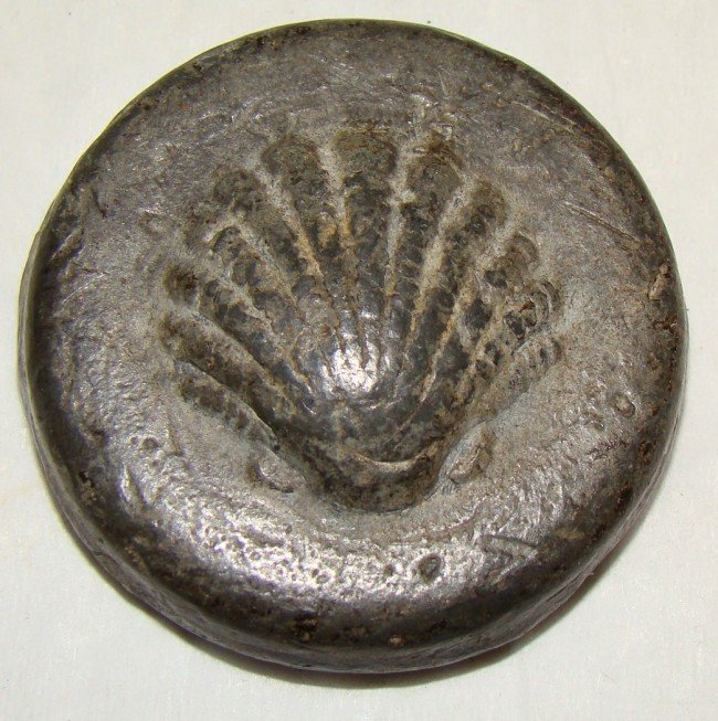 22: Egypt, round bronze weight with scallop shell