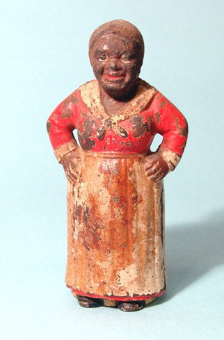 """2002: Miniature """"Aunt Jemima"""" iron bank. She stand with"""