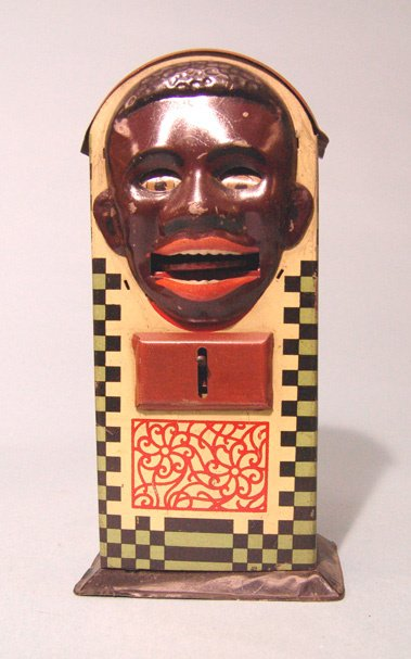 2005: Antique tin mechanical coin eating bank. In the s