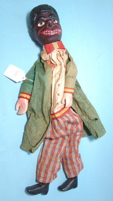 2162: European stick puppet. Wood, hand carved head, fe