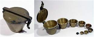 SPAIN, c. 1800, a brass set of nested wei