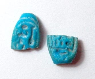 5: Lot of 2 faience bezels. 1). Lower portion of a blue