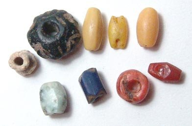 23: Lot of 9 beads. Three yellow glass beads, 1 blue gl
