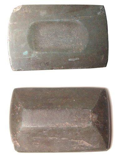 70: A rectangular basalt grinding dish for ink.