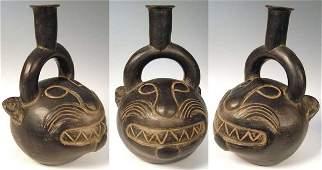 391 Peru ChimuInca a blackware bottle depicting a f