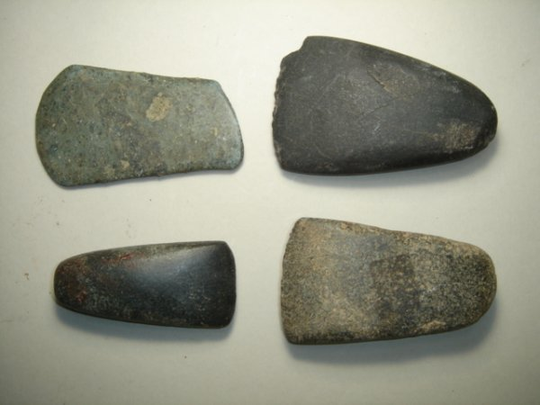 2002: A lot of four small stone pre-historic hand axes.