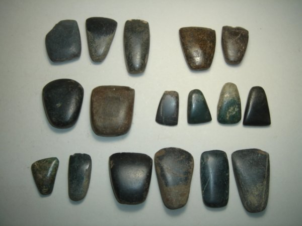 """2005: A large lot of 17 small stone axes. All about 1""""-"""
