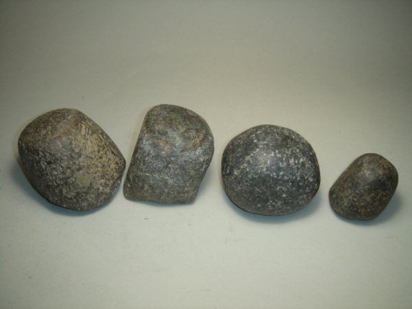2007: A lot of 4 large basalt stone weights? Four stone