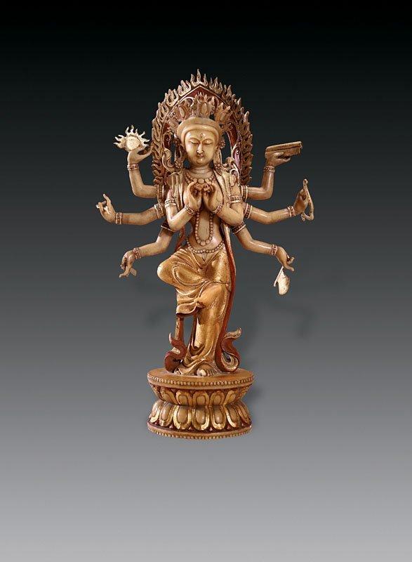 583: Rare gilt Ivory muti-arms Godess statue; Qing